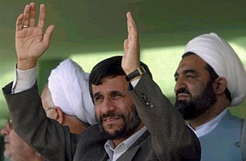 ahmadinejad hands up 298 (photo credit: AP [file])