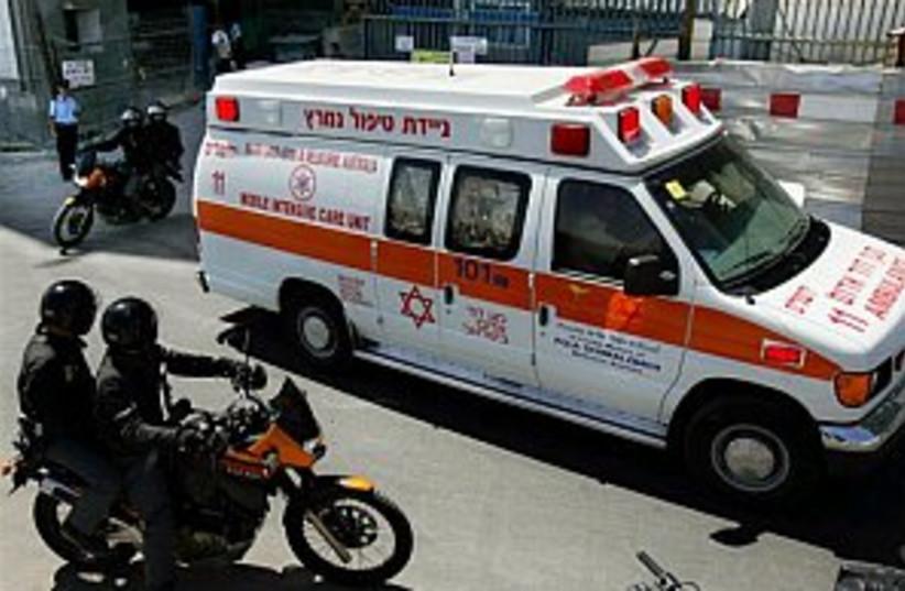 sharon ambulance 298 ap (photo credit: AP)