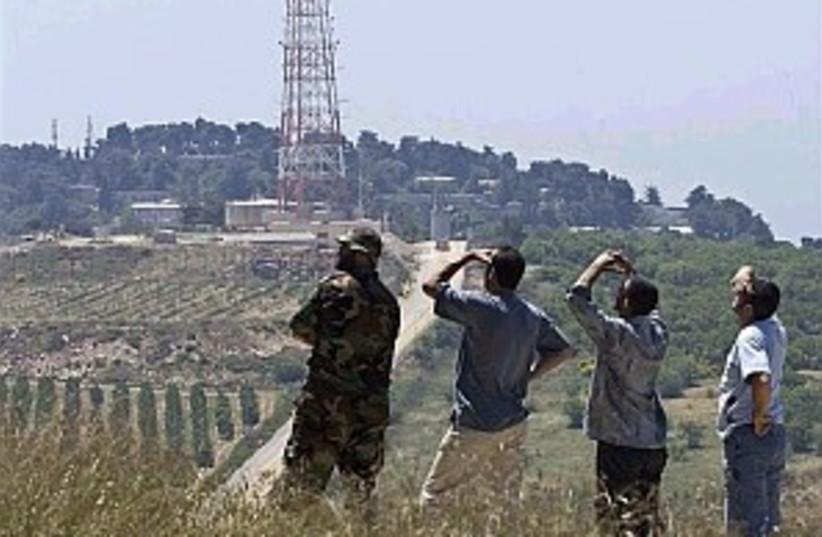 hizbullah watching 298 (photo credit: AP)