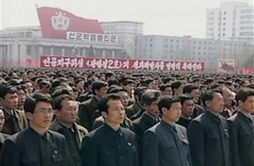 north korea rocket rally nuts 248 (photo credit: )