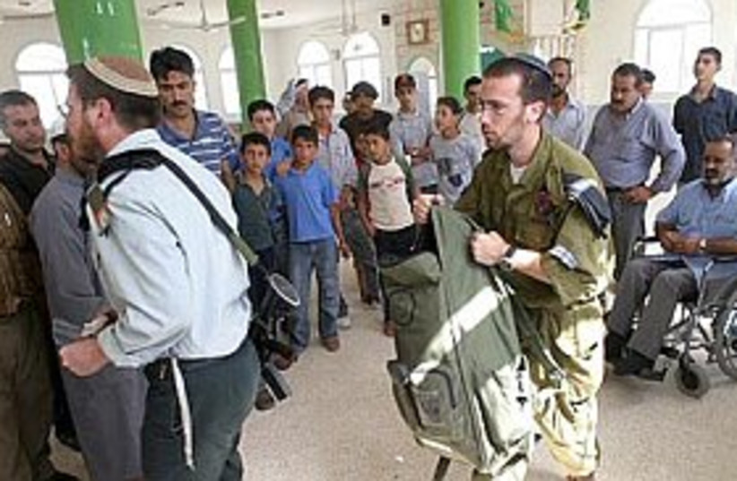 Mosque soldier suicide (photo credit: AP)