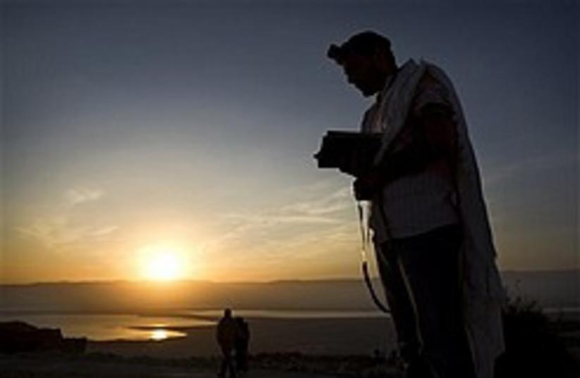 sunrise masada pray 248 88 ap (photo credit: AP)