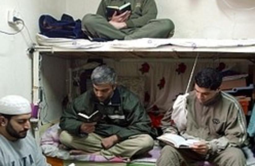 pal prisoners praying 248 88 (photo credit: Ariel Jerozolimski [file])