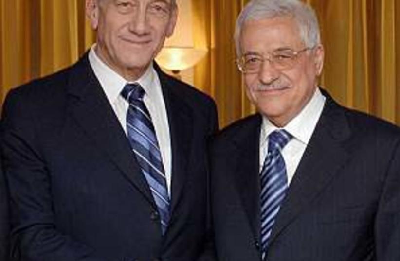 olmert and abbas shake h (photo credit: GPO [file])