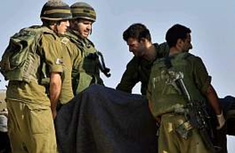 soldiers kerem shalom (photo credit: AP [file])