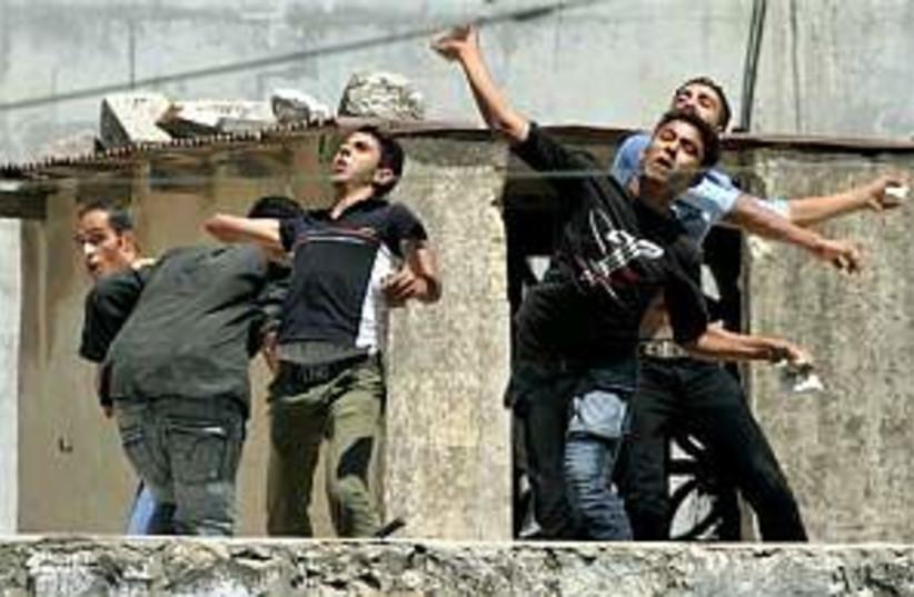 pal stone throwers , nab (photo credit: AP)