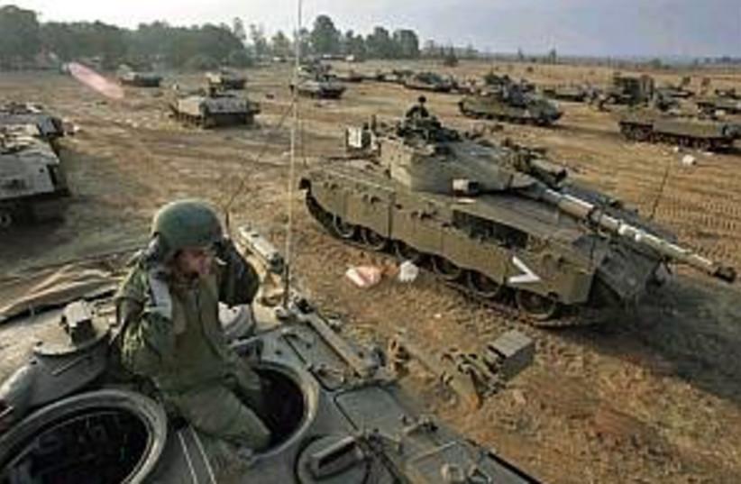 armor ammases outside ga (photo credit: AP)