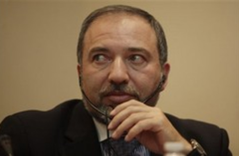 Foreign Minister Avigdor Lieberman gestures during (photo credit: AP)