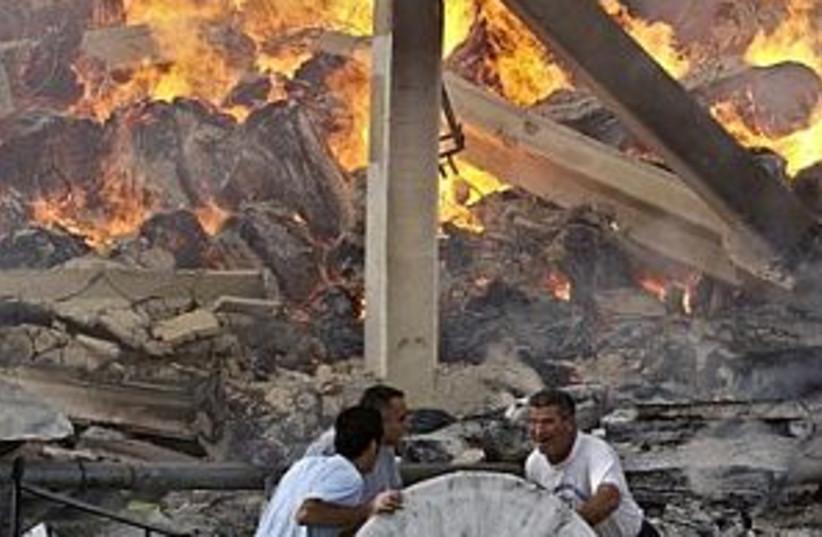 fire in village 298 ap  (photo credit: AP)