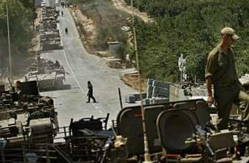 idf tanks on northern bo (photo credit: AP)