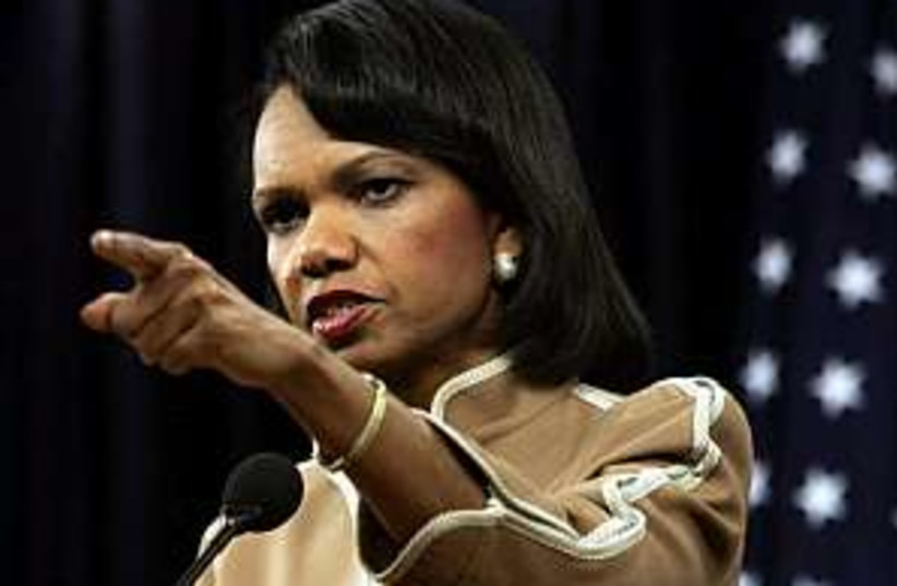 condi rice pointing and  (photo credit: AP [file])