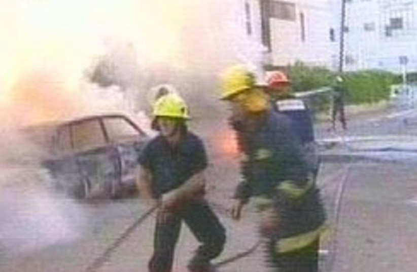firefighters katyusha  (photo credit: Channel 2)