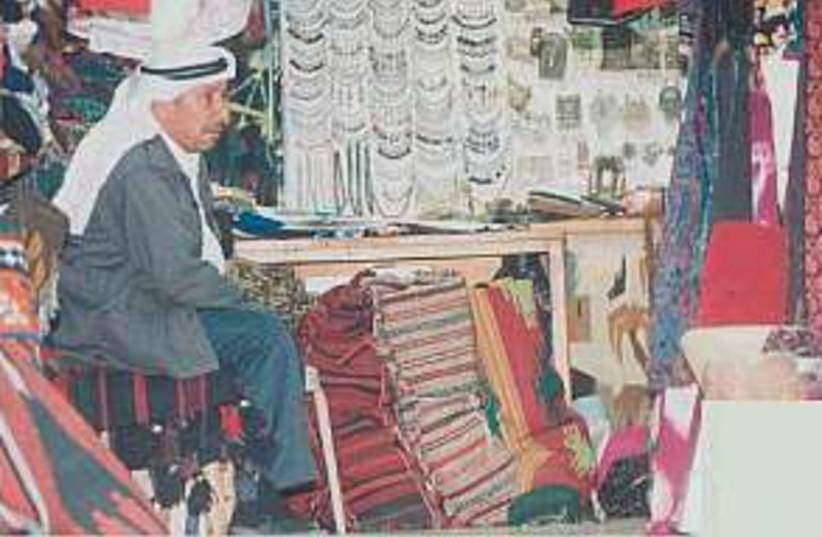 arab shopkeeper 298.88 (photo credit: Ariel Jerozolimski )