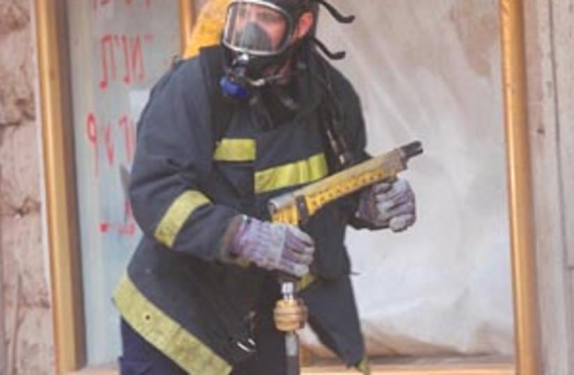 mask fireman 88 298 (photo credit: Ariel Jerozolimski)