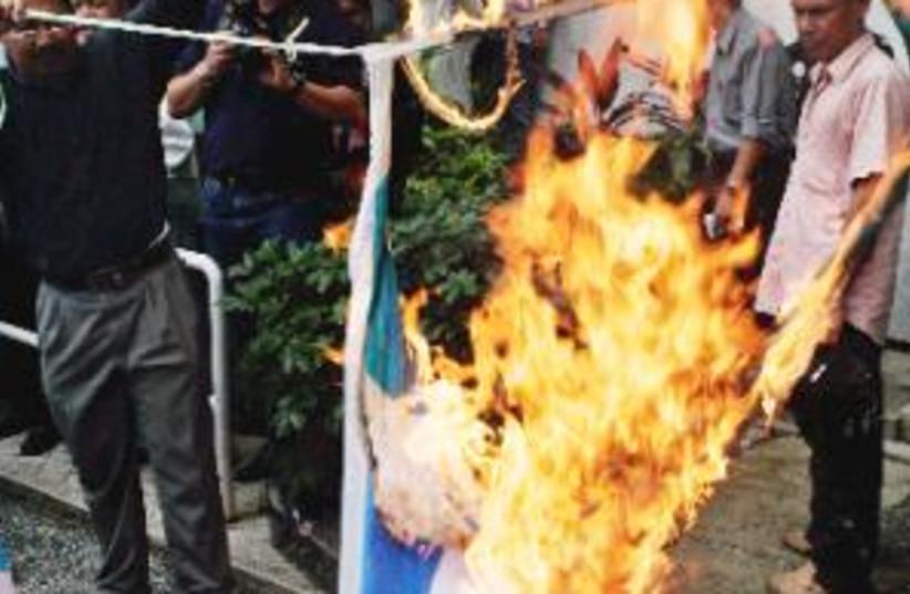 burning israeli flag 298 (photo credit: AP)
