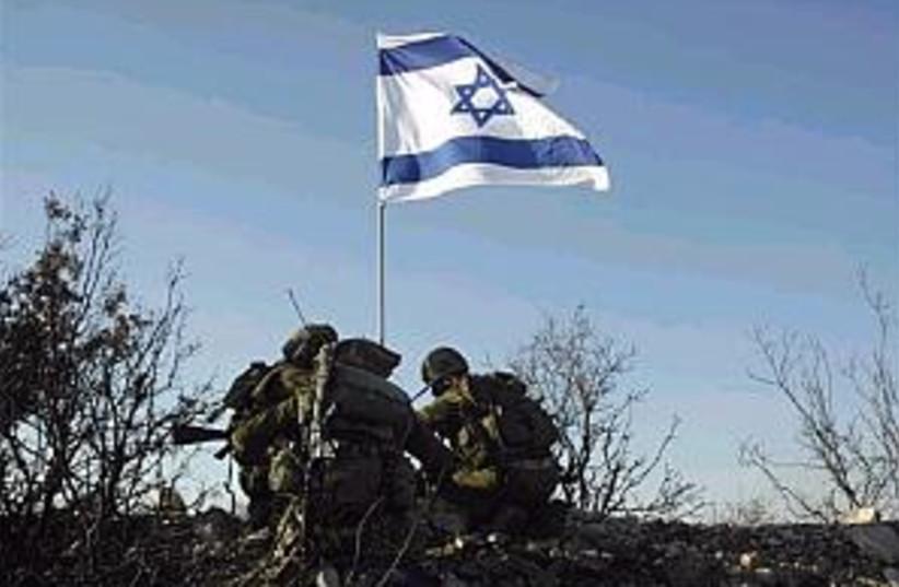 idf israeli flag lebanon (photo credit: AP)