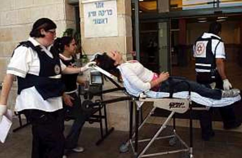 wounded stretcher 298 (photo credit: Ariel Jerozolimski)