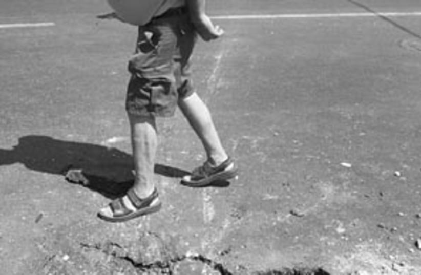 road damage 298  (photo credit: Ariel Jerozolimski)