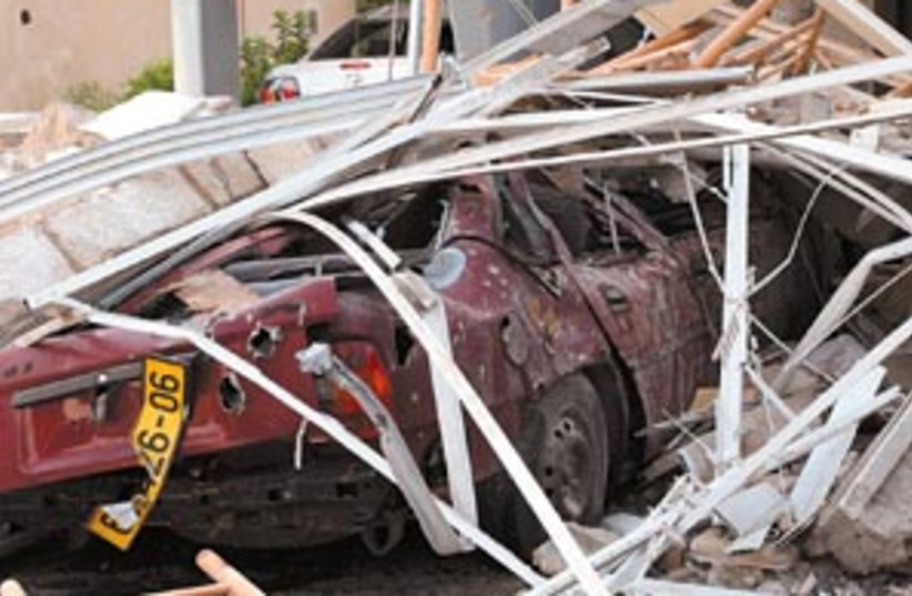 car north damage 88 298 (photo credit: Ariel Jerozolimski)