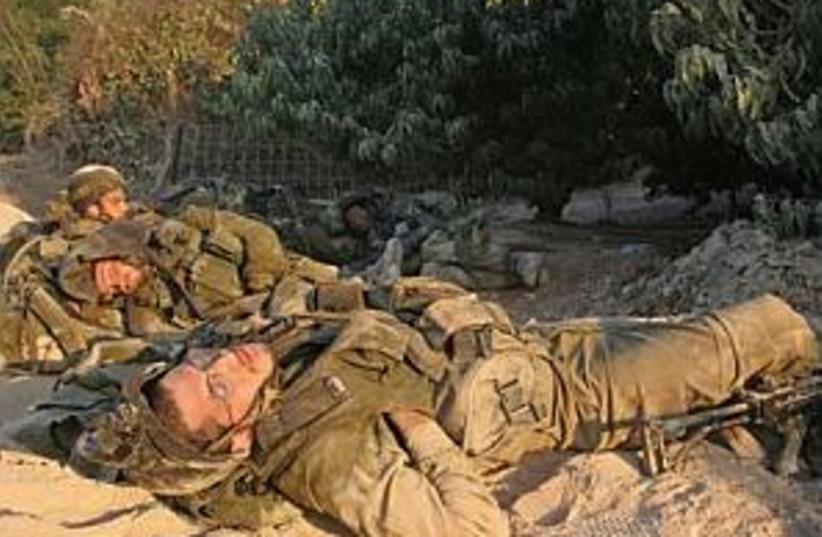 soldiers sleep 298 ap (photo credit: AP)