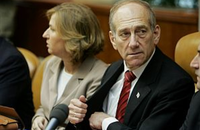 olmert reaches in pocket (photo credit: AP)