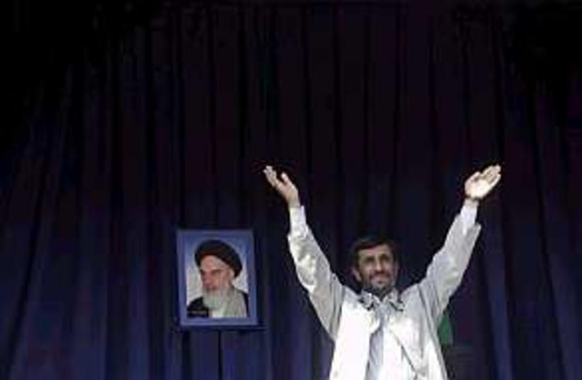 Ahmadinejad hands 298.88 (photo credit: AP)