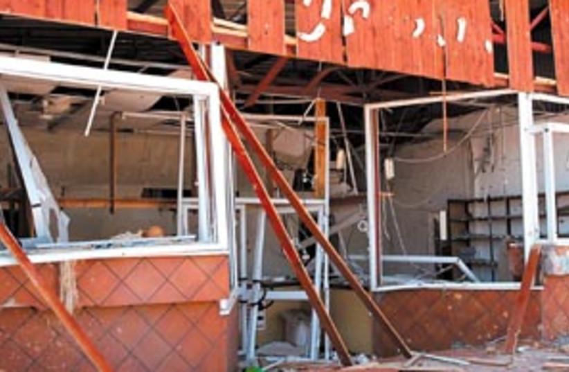 damage katyusha 88 298 (photo credit: Ariel Jerozolimski)