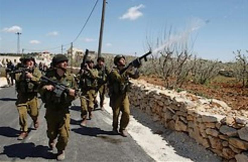 soldier tear gas palestinians 248 88ap (photo credit: )
