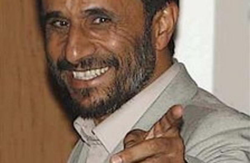 ahmadinejad smiles298.88 (photo credit: AP)