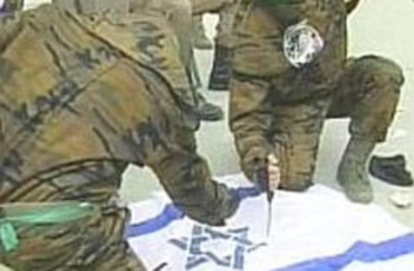 hamas destroys Israel fl (photo credit: Channel 1)