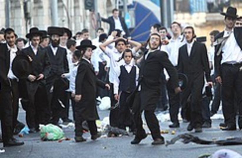 A protest in a haredi neighborhood in Jerusalem.  (photo credit: Ariel Jerozolimski)