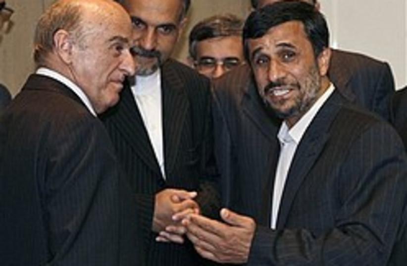 ahmadinejad Merz geneva 248 88 ap (photo credit: AP)