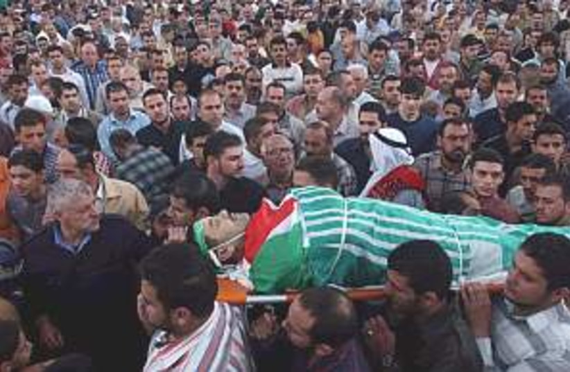 dead palestinian 298.88 (photo credit: AP)