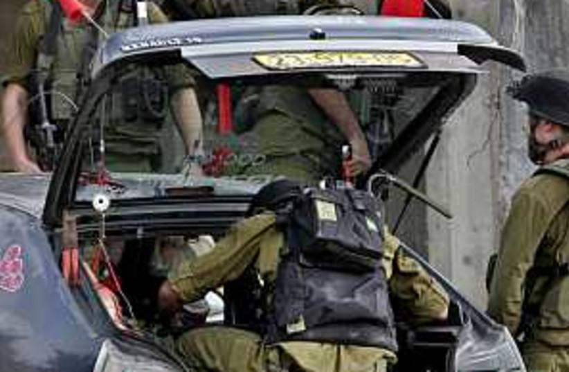 hebron arrest 298 88 (photo credit: AP)