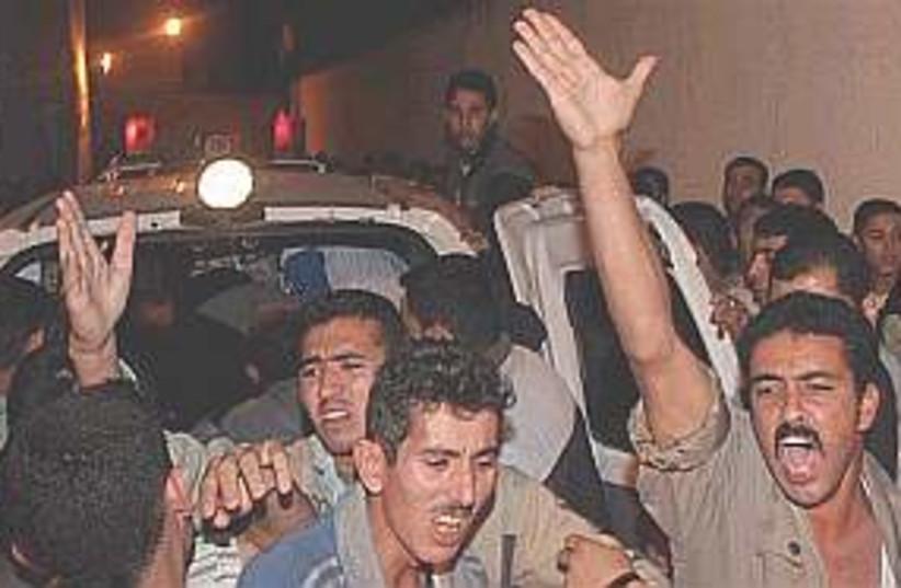 Palestinians angry 298.8 (photo credit: AP)