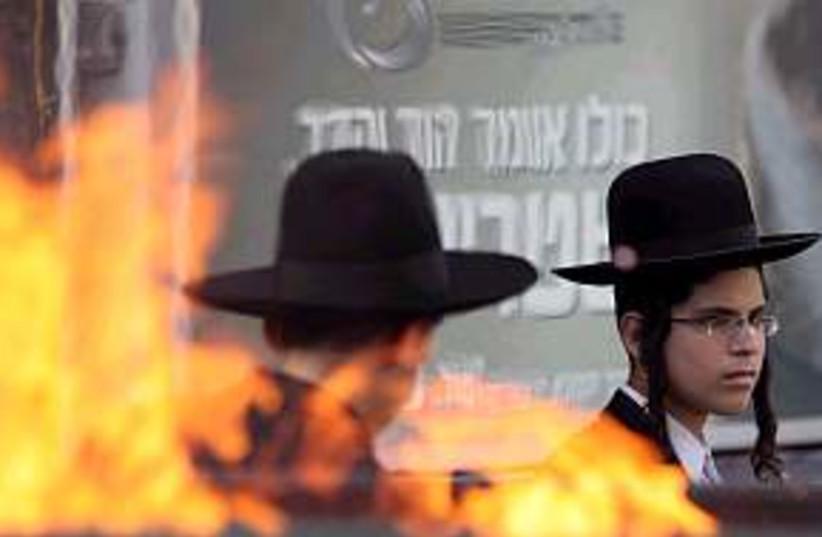 haredi riot flames (photo credit: Ariel Jerozolimski)