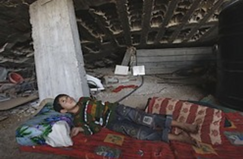 gaza boy destroyed house 248 88 ap (photo credit: )