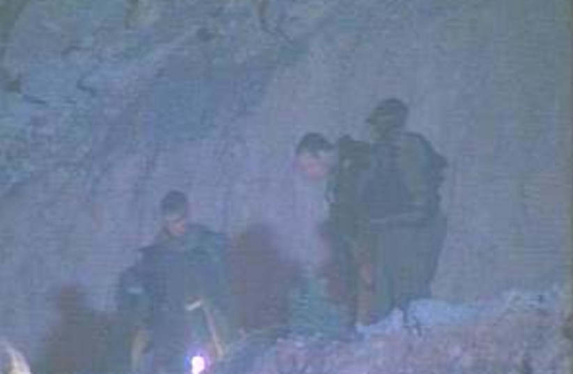 troops search 298.88 (photo credit: Channel 10)