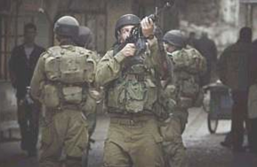 troops in hebron very ni (photo credit: AP [file])