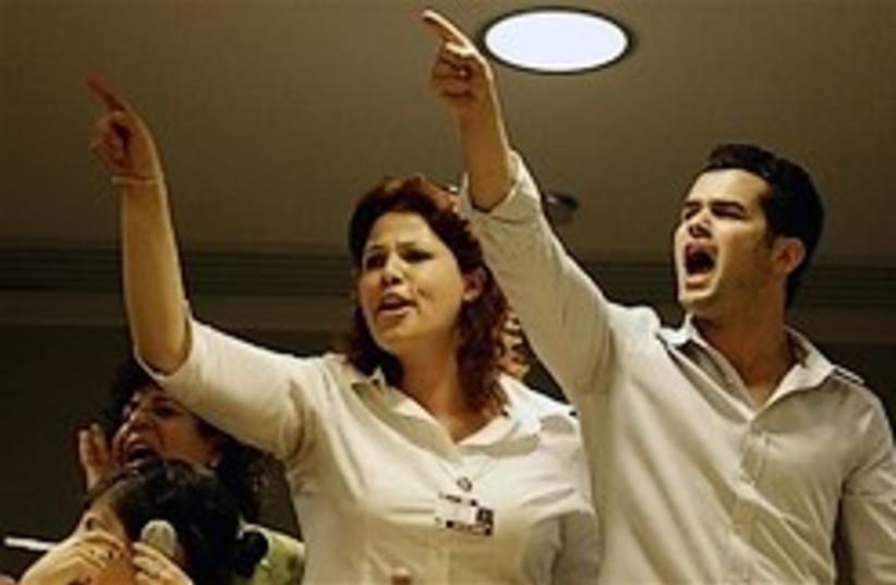 shouting at ahmadinejad geneva 248 ap (photo credit: AP [file])