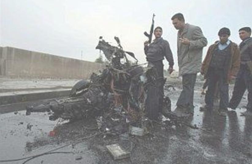 iraq triple bomb 298.88 (photo credit: AP)