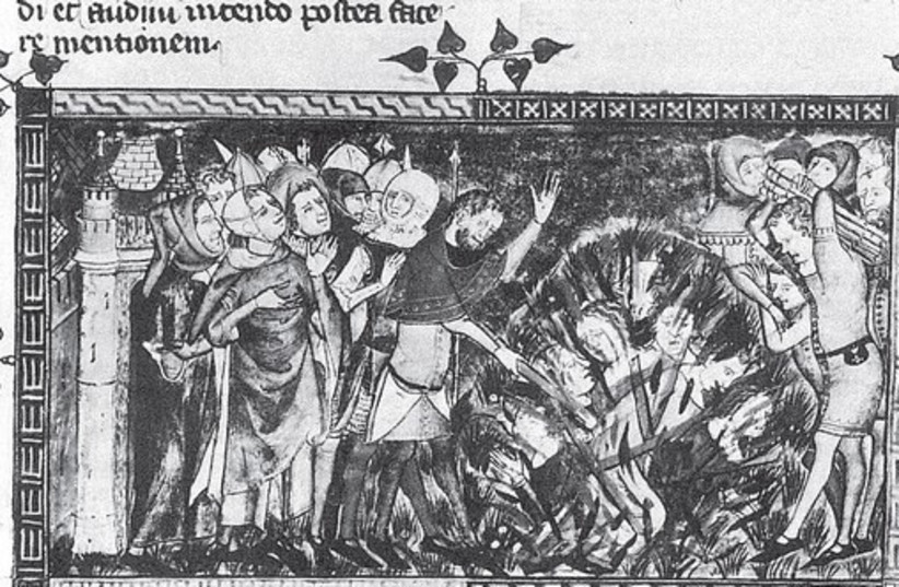 A MEDIEVAL MANUSCRIPT shows Jews burned at the stake in Flanders according to the popular antidote to the Black Death. (credit: Wikimedia Commons)
