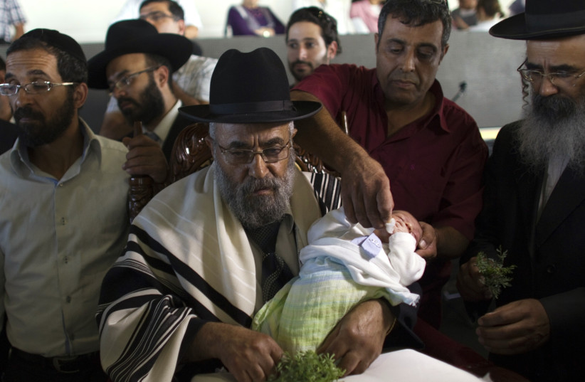 Circumcision in Israel (photo credit: REUTERS/Ronen Zvulun)