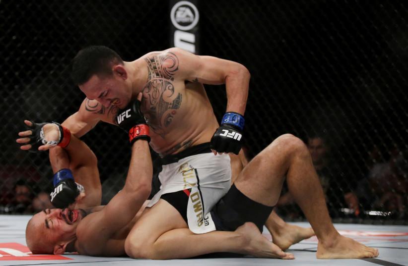 Mixed Martial Arts (MMA) fighters. (photo credit: RICARDO MORAES/REUTERS)