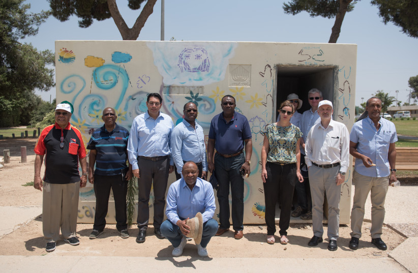 UN Ambassador Danny Danon poses with a delegation of his counterparts during their tour of Kibbutz Nahal Oz on Thursday.  (photo credit: SHAY WAGNER)