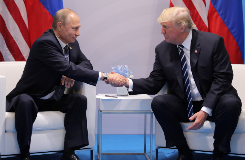 President Donald Trump shakes hands with Russia's President Vladimir Putin. (photo credit: REUTERS/CARLOS BARRIA)
