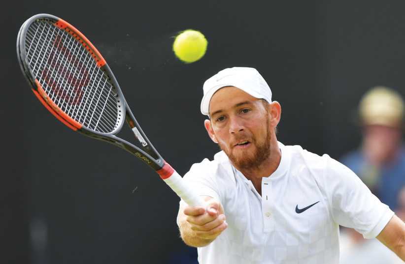 DUDI SELA'S impressive run at Wimbledon came to an end yesterday, as the 32-year-old Israeli fell to Bulgaria's Grigor Dimitrov, retiring after losing the first two sets 6-1, 6-1. (photo credit: REUTERS)