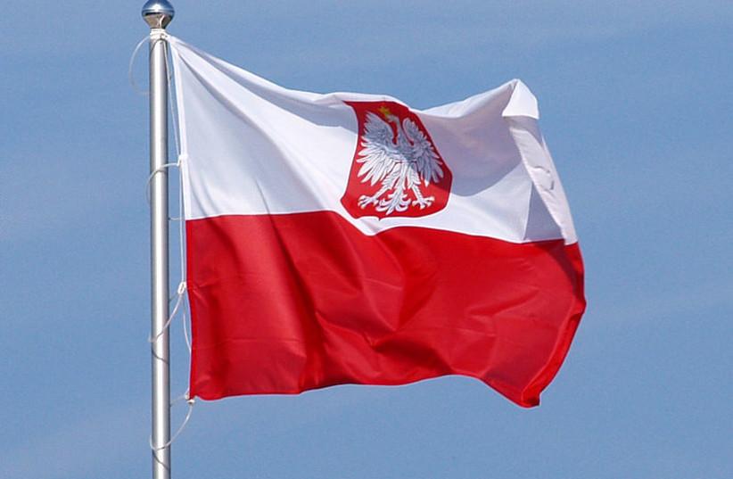 Flag of Poland, variant polish coat of arms. (photo credit: OLEK REMESZ/ WIKEPEDIA COMMONS)