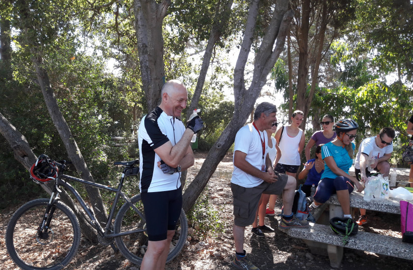 Austrian ambassador Martin Weiss during the rest at the half-way mark of a 17 km ride. (photo credit: HERB KEINON)