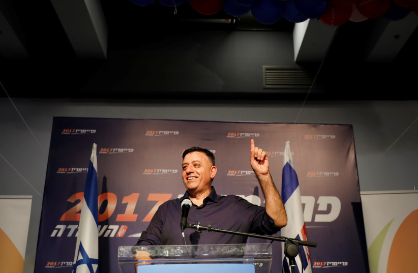 Avi Gabbay, the new leader of Israel's centre-left Labor party, delivers his victory speech after winning the Labor party primary runoff, at an event in Tel Aviv (photo credit: REUTERS/AMIR COHEN)